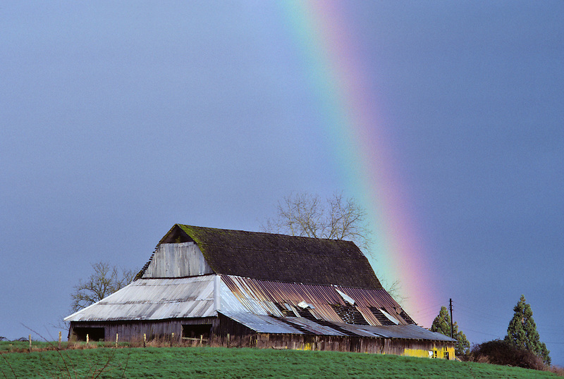 Barn and rainbow with storm clouds. Near Corvallis, Oregon.