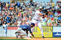 Detroit Tigers shortstop Omar Infante #4 attempts to turn a double play as Sean Rodriguez #1 slides in during a Spring Training game against the Tampa Bay Rays at Joker Marchant Stadium on March 29, 2013 in Lakeland, Florida.  (Mike Janes/Four Seam Images)