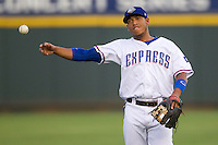 Round Rock Express second baseman Yangervis Solarte (26) warms up before the the Pacific Coast League baseball game against the Iowa Cubs on July 21, 2013 at the Dell Diamond in Round Rock, Texas. Round Rock defeated Iowa 3-0. (Andrew Woolley/Four Seam Images)