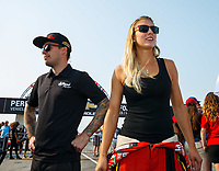 Sep 4, 2017; Clermont, IN, USA; NHRA top fuel driver Leah Pritchett (right) and funny car driver Jonnie Lindberg during the US Nationals at Lucas Oil Raceway. Mandatory Credit: Mark J. Rebilas-USA TODAY Sports