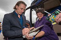 Gareth Ainsworth, Manager of Wycombe Wanderers,  signs autographs on arriving at Vale Park ahead of the Sky Bet League 2 match between Port Vale and Wycombe Wanderers at Vale Park, Burslem, England on 12 August 2017. Photo by David Horn.