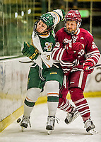 15 November 2015: University of Massachusetts Minuteman Forward Maddison Smiley, a Sophomore from Airdrie, Alberta, checks University of Vermont Catamount Defenseman Mike Lee, a Freshman from Hamden, CT, at Gutterson Fieldhouse in Burlington, Vermont. The Minutemen rallied from a three goal deficit to tie the game 3-3 in their Hockey East matchup. Mandatory Credit: Ed Wolfstein Photo *** RAW (NEF) Image File Available ***