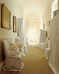 Dust sheets cover the furniture in the Stone Corridor. The corridor was an extension built by William Windham II in 1751-2.