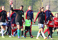 Boyds, MD - Saturday May 07, 2016: Portland Thorns FC midfielder Tobin Heath (17) and  goalkeeper Adrianna Franch (24) lead the teams onto the field before a regular season National Women's Soccer League (NWSL) match at Maureen Hendricks Field, Maryland SoccerPlex. Washington Spirit tied the Portland Thorns 0-0.