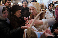 Moscow, Russia, 06/01/2011..Holy bread is distributes as Russian Christians attend an Orthodox Christmas service at Peter Paul church in central Moscow, late on Christmas Eve. Christmas falls on January 7 for Orthodox believers in the Holy Land, Russia and other Orthodox churches that use the old Julian calendar instead of the16th-century Gregorian calendar.