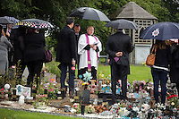 Pictured: A priest reads from the order of service during the burial at Thornhill Cemetery, Cardiff, Wales, UK. Tuesday 28 June 2016<br /> Re: The funeral of Sion, the baby boy found dead in the River Taff in Cardiff has taken place<br /> Generous locals raised nearly £1,400 for the memorial after reading about plans to hold a fitting ceremony for the newborn baby whose body was discovered in Cardiff a year ago.<br /> The funeral took place at the Briwnant Chapel at Thornhill Crematorium, Cardiff. Members of the public are invited to be among the congregation.