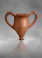 Hittite terra cotta two handled drinking vessel. Hittite Period, 1600 - 1200 BC.  Hattusa Boğazkale. Çorum Archaeological Museum, Corum, Turkey. Against a grey bacground.