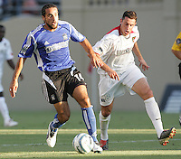 23 July 2005: Dwayne De Rosario of the Earthquakes dribbles the ball away from Mark Lisi of the MetroStars at Spartan Stadium in San Jose, California.  Earthquakes defeated MetroStars, 2-1.  Credit: Michael Pimentel / ISI