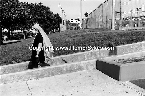 Man in fancy dress and painted face with dogs tail San Francisco California USA 2001. .