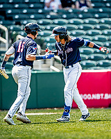 6 June 2021: New Hampshire Fisher Cats infielder Austin Martin is greeted by Jordan Groshans after hitting a solo home run to open the scoring in the bottom of the first inning against the Binghamton Rumble Ponies at Northeast Delta Dental Stadium in Manchester, NH. The Rumble Ponies defeated the Fisher Cats 9-6 to close out their 6-game series. Mandatory Credit: Ed Wolfstein Photo *** RAW (NEF) Image File Available ***