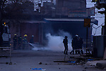 SULAIMANIYAH, IRAQ: The police apprehend a protester while firemen put out a blaze...A third day of violence rocks the Iraqi Kurdish city of Sulaimaniyah.  Tensions between protesters and security forces flare after the security forces continue to use life ammunition during the demonstrations...Photo by Ali Arcady
