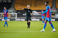 30th October 2020; Molineux Stadium, Wolverhampton, West Midlands, England; English Premier League Football, Wolverhampton Wanderers versus Crystal Palace; Referee points to the penalty spot spot for Crystal Palace but VAR overrules his decision