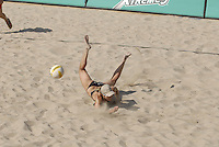 Huntington Beach, CA - 5/5/07:   Elaine Youngs dives for the ball during Branagh / Youngs' 21-19, 21-16 victory over Turner / Wacholder Saturday during the 2007 AVP CROCS Tour in Huntington Beach..Photo by Carlos Delgado