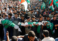 "Mourners carry the bodies of four Palestinian children from the Abu Maateq family during their funeral in Beit Lahia in the northern Gaza Strip on April 28, 2008. Four children, aged one to five, their mother and a militant were killed in Israeli operations in Gaza today as Palestinian factions headed to Egypt for talks on a possible truce. The four siblings -- aged one, three, four and five -- were killed when a tank shell hit their home in the town of Beit Hanun, and their mother died later of her wounds, doctors at the Kamal Radwan hospital said.""photo by Fady Adwan"""