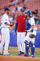 Buffalo Bisons pitching coach Bob Stanley (46) talks with pitcher Scott Diamond (17) and catcher Tony Sanchez (26) during a game against the Lehigh Valley IronPigs on July 9, 2016 at Coca-Cola Field in Buffalo, New York.  Lehigh Valley defeated Buffalo 9-1 in a rain shortened game.  (Mike Janes/Four Seam Images)