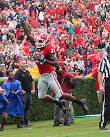 The Georgia Bulldogs played North Texas Mean Green at Sanford Stadium.  After North Texas tied the game at 21 early in the second half, the Georgia Bulldogs went on to score 24 unanswered points to win 45-21.  Georgia Bulldogs wide receiver Chris Conley (31) celebrate  touchdown catch.
