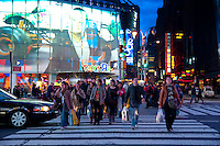 People Cross the Street Near Toys R Us Store On Times Square, New York City, USA