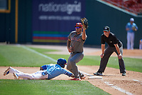 Lehigh Valley IronPigs first baseman Damek Tomscha (13) catches a pickoff attempt throw as Jonathan Davis (1) dives back to the bag with umpire Richard Riley looking on during an International League game against the Buffalo Bisons on June 9, 2019 at Sahlen Field in Buffalo, New York.  Lehigh Valley defeated Buffalo 7-6 in 11 innings.  (Mike Janes/Four Seam Images)