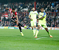 Ollie Watkins of Brentford shoots on goal during the Sky Bet Championship match between Brentford and Derby County at Griffin Park, London, England on 26 September 2017. Photo by Carlton Myrie / PRiME Media Images.