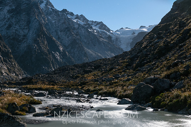 Butler River flowing out of Ice Lake under moonlight with Whataroa Glacier in background, South Westland, West Coast, New Zealand, NZ