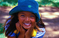 Young Filipino girl smiling with a hat on