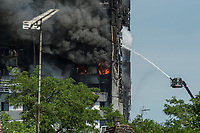Firefighters continue to hose down a blaze that started in Grenfell Tower in West London. Most of the block was completely destroyed. 14-6-17