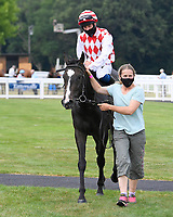Winner of The Whiteparish Handicap  Amazon Princess (red/white) ridden by George Rooke and trained by Tony Newcombe is led into the Winners enclosure during Horse Racing at Salisbury Racecourse on 13th August 2020