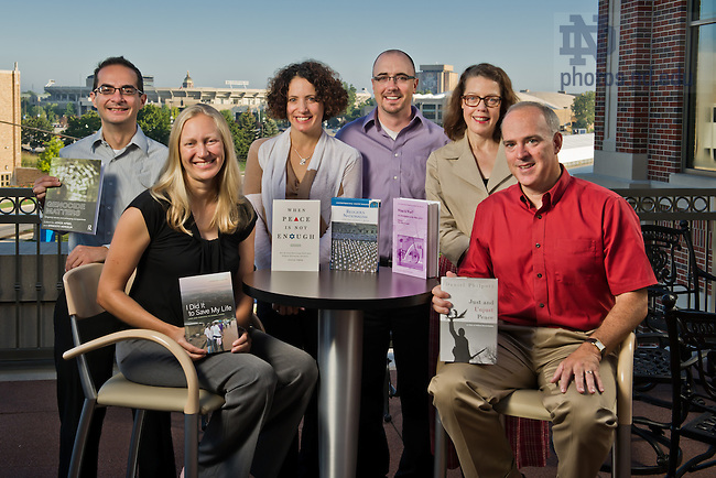 Aug. 23, 2013; Kroc Institute fellows and faculty with books they authored and/or edited.  From l-r: Ernesto Verdeja, Catherine Bolten, Atalia Omer, Jason Springs, Mary Ellen O'Connell, Daniel Philpott.<br /> <br /> Photo by Matt Cashore/University of Notre Dame