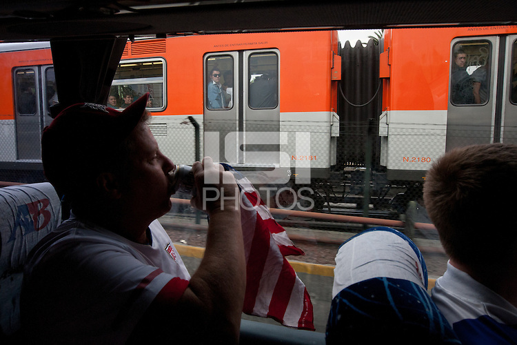 USA fan James Cates enjoy a beer while taking a a bus to the USA vs. Mexico World Cup Qualifier at Azteca stadium in Mexico City, Mexico on March 26, 2013.