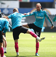 1st May 2021; Liberty Stadium, Swansea, Glamorgan, Wales; English Football League Championship Football, Swansea City versus Derby County; Matthew Clarke of Derby County stretches during warm up