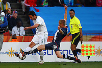 Zlatan Ljubijankic of Slovenia (L) and Jay DeMerit of USA (