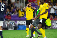 ORLANDO, FL - JULY 20: Andre Gray #14 of Jamaica reacts to missing a scoring chance during a game between Costa Rica and Jamaica at Exploria Stadium on July 20, 2021 in Orlando, Florida.
