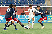 FOXBOROUGH, MA - OCTOBER 09: Edison Azcona #21 of Fort Lauderdale CF tries to evade three New England players in a tackle during a game between Fort Lauderdale CF and New England Revolution II at Gillette Stadium on October 09, 2020 in Foxborough, Massachusetts.