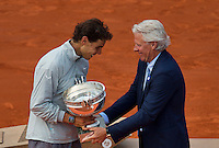France, Paris, 08.06.2014. Tennis, French Open, Roland Garros, Final men: Rafael Nadal (ESP) receives the trophy  out of the hands of former winner Bjorn Borg<br /> Photo:Tennisimages/Henk Koster