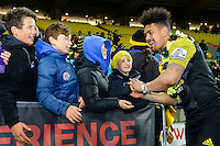 Ardie Savea Hi-Fives fans after the Super Rugby Final between The Hurricanes and The Lions at Westpac Stadium, Wellington, New Zealand on Saturday, 6 August 2016. Photo: Marco Keller / lintottphoto.co.nz