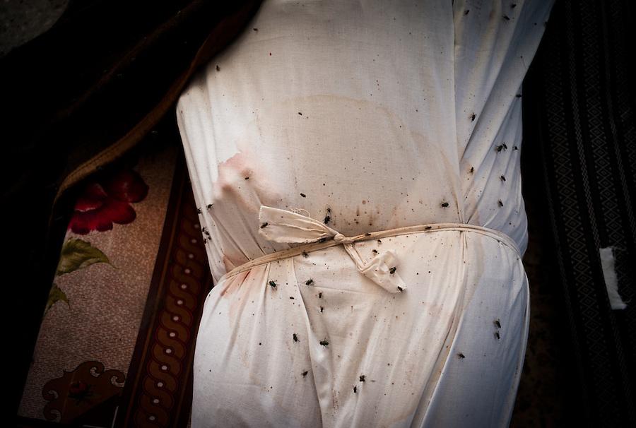 Wrapped body found in abandoned hospital previously under Gaddafi loyalist control in Sirte, Libya.