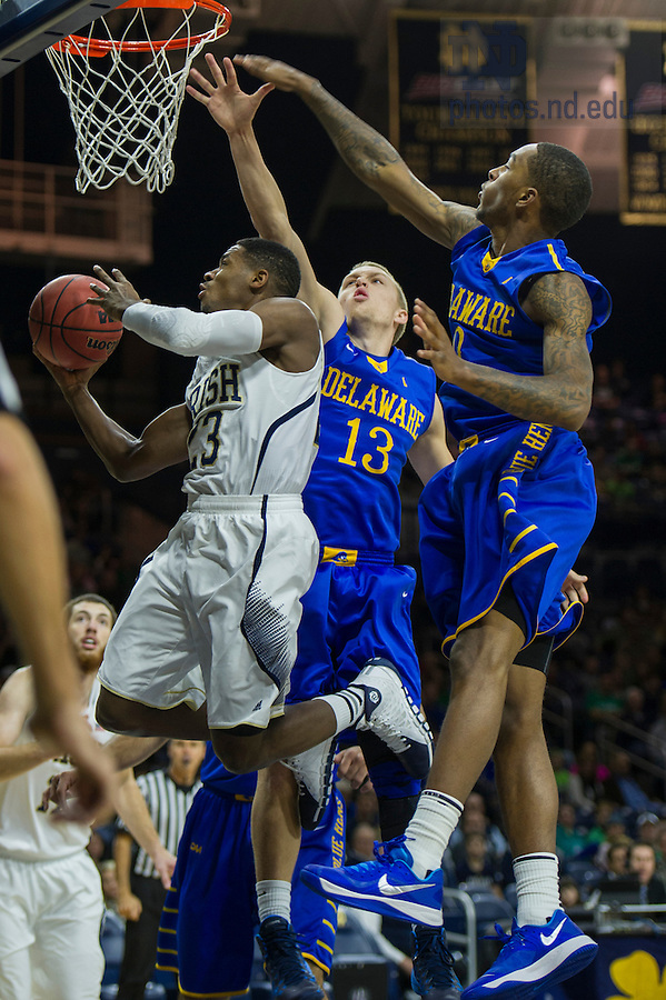 Dec. 7, 2013;  Notre Dame guard Demetrius Jackson goes up for a shot as Delaware guards Kyle Anderson and Davon Usher defend in the first half.  Photo by Barbara Johnston/University of Notre Dame
