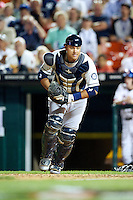 Tacoma Rainers catcher Guillermo Quiroz #18 during the Triple-A All-Star game featuring the Pacific Coast League and International League top players at Coca-Cola Field on July 11, 2012 in Buffalo, New York.  PCL defeated the IL 3-0.  (Mike Janes/Four Seam Images)