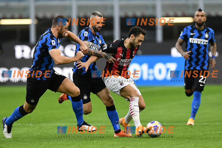 Stefan de Vrij , Marcelo Brozovic of FC Internazionale and Hakan Calhanoglu of AC Milan compete for the ball <br /> during the Serie A football match between FC Internazionale and AC Milan at stadio San Siro in Milano (Italy), October 17th, 2020. Photo Image Sport / Insidefoto