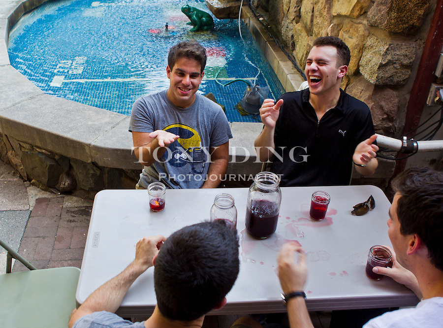 University of Michigan grad Eric Meer, top left, shares laughs and pitchers of Dominick's home-made sangria, in their traditional mason jars, with his fellow Class of 2008 alumni, Friday, Sept. 2, 2011 in Ann Arbor, Mich. (Tony Ding for The New York Times)