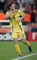 Ukrainian  midfielder (15) Blerim Dzemaili silences the Swiss crowd with a successful penalty kick.  Ukraine defeated Switzerland on penalty kicks in their FIFA World Cup round of 16 match at FIFA World Cup Stadium in Cologne, Germany, June 26, 2006.