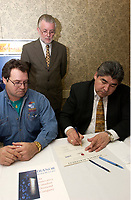 Feb 14, 2002, Montreal, Quebec, Canada; <br /> <br /> <br /> Wemindji Exploration Inc Manager and Exploration Director ; Claude Jacques (L) <br />  and Dianor Inc President;  John Ryder (standing) watch<br /> Canadian Cree  leader Dr. Ted Moses (R)<br /> sign a partnership deal for diamond exploration and mining in the James Bay area of Northen Quebec.<br /> Feb 14, 2002, , in Montreal, Canada.<br /> <br /> Rights and profits will be shared equally between Dianor Inc and Cree indian owned Weminji Exploration Inc.<br /> <br /> Dianor ticker symbol is DOR : CDNX<br /> <br /> (Mandatory Credit: Photo by Sevy - Images Distribution (©) Copyright 2002 by Sevy<br /> <br /> NOTE :  D-1 H original JPEG, saved as Adobe 1998 RGB.