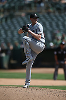 OAKLAND, CA - SEPTEMBER 9:  Ryan Burr #61 of the Chicago White Sox pitches against the Oakland Athletics during the game at the Oakland Coliseum on Thursday, September 9, 2021 in Oakland, California. (Photo by Brad Mangin)