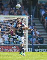 Aston Villa Robert Snodgrass and Millwall's Lee Gregory during the Sky Bet Championship match between Millwall and Aston Villa at The Den, London, England on 6 May 2018. Photo by Andrew Aleksiejczuk / PRiME Media Images.