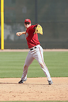 Bobby Borchering #34 of the Arizona Diamondbacks plays in a minor league spring training game against the Cincinnati Reds at the Diamondbacks minor league complex on March 15, 2011  in Scottsdale, Arizona. .Photo by:  Bill Mitchell/Four Seam Images.