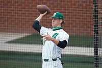 Charlotte 49ers pitcher Casey Bargo (50) stays loose between innings by throwing a football during the game against the Old Dominion Monarchs at Hayes Stadium on April 23, 2021 in Charlotte, North Carolina. (Brian Westerholt/Four Seam Images)