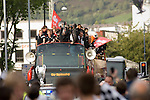 Swansea City Football Club players and staff celebrating their promotion to the Premier League with an opentop bus tour of the city, where thousands of supporters turned out to show their appreciation..