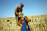 A child worker at a brick making factory in Fatullah near Dhaka. The workers come from the rural area of Gaibandha, and work at the brick factory until June, when the Monsoon stops work at the factory, and they return to their homes. For each thousand bricks they carry, they earn the equivalent of 0.9 USD.