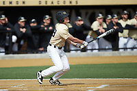 Chase Mascolo (28) of the Wake Forest Demon Deacons follows through on his swing against the Louisville Cardinals at David F. Couch Ballpark on March 18, 2018 in  Winston-Salem, North Carolina.  The Demon Deacons defeated the Cardinals 6-3.  (Brian Westerholt/Four Seam Images)