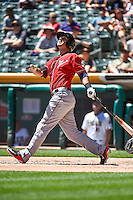 Tommy Medica (24) of the El Paso Chihuahuas at bat against the Salt Lake Bees in Pacific Coast League action at Smith's Ballpark on July 26, 2015 in Salt Lake City, Utah. El Paso defeated Salt Lake 6-3 in 10 innings. (Stephen Smith/Four Seam Images)